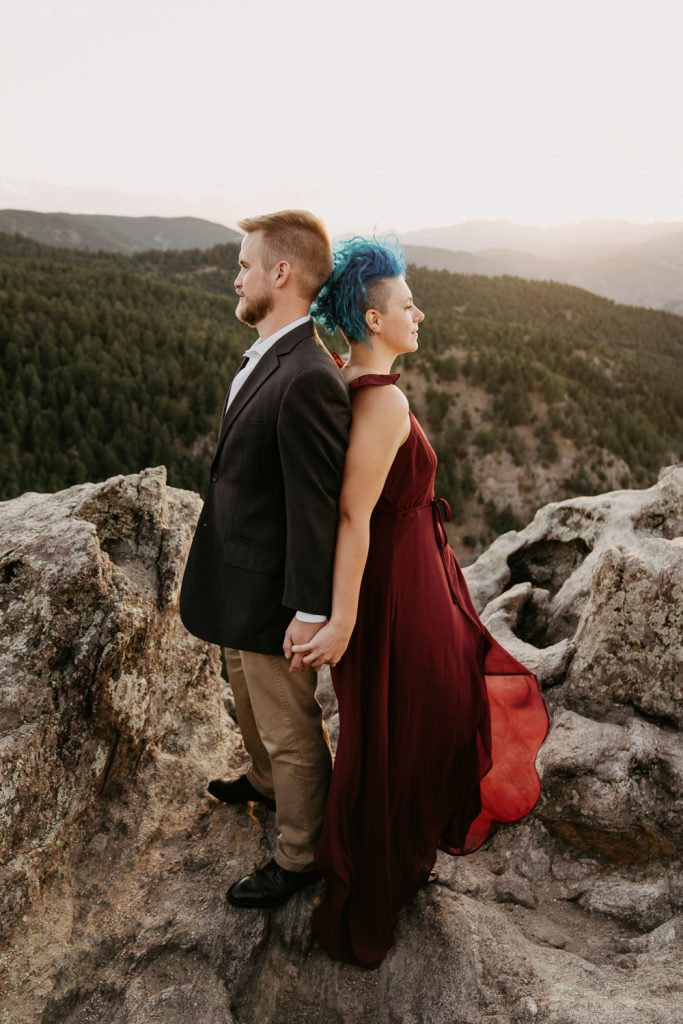 I call this the album cover pose, standing back to back, you two against the world. The Colorado wind blew at the perfect time to show off Elise's red dress at Lost Gulch Overlook