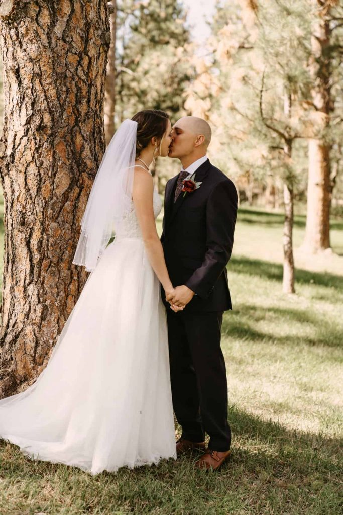 Bride and groom can't help but to go in for a kiss before after they see each other