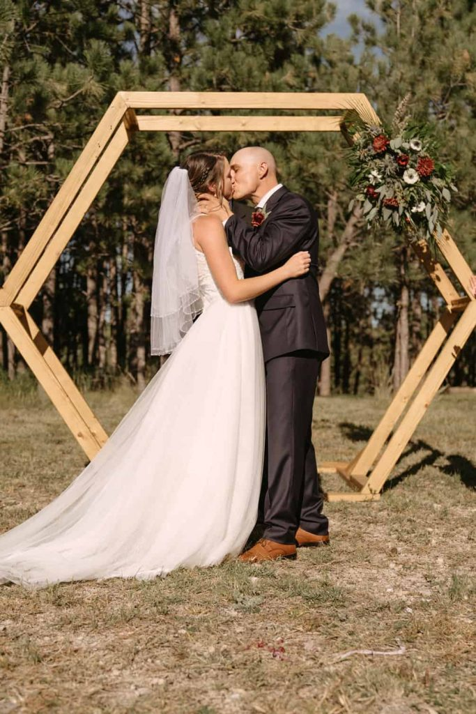 Bride and groom's first kiss as a married couple at Woodlands Receptions