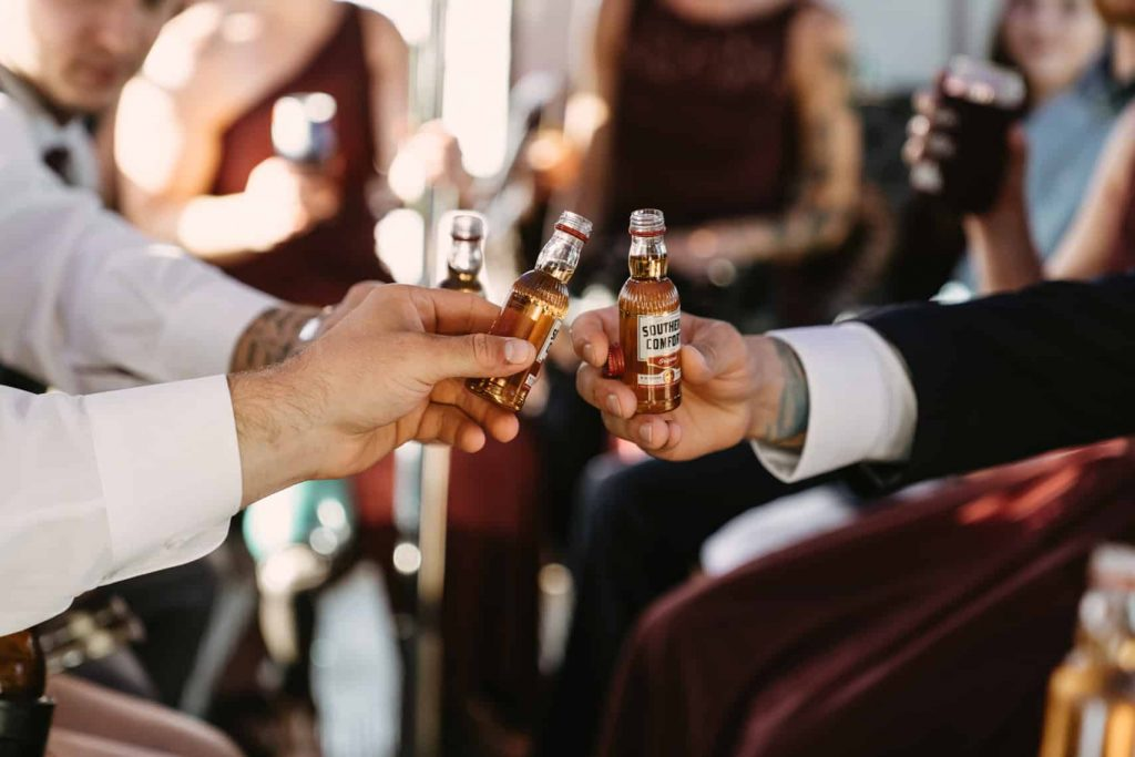 Close up photo of whiskey shooters for the groomsmen