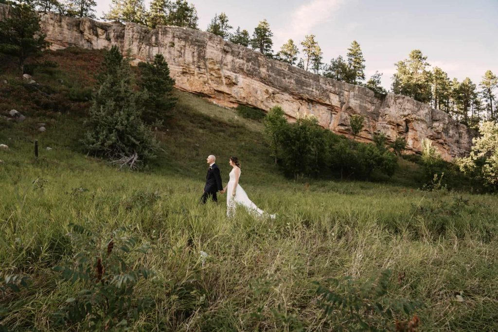 We took the bride and groom's bridal portraits about 10 minutes away from their ceremony in a beautiful grassy field with a rock cliff back drop