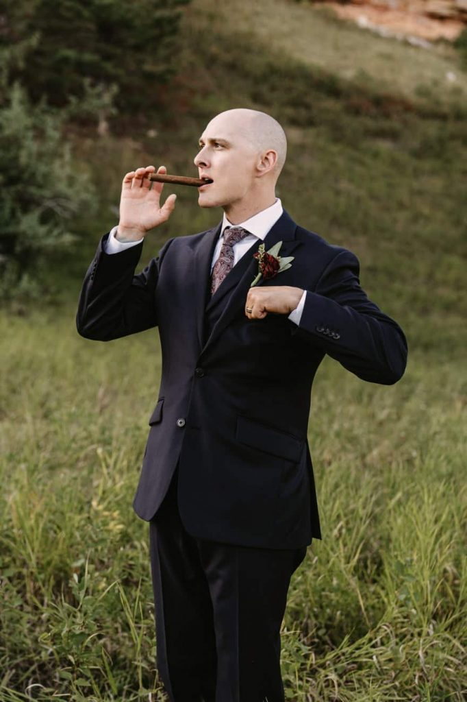 Groom pretending to light his cigar