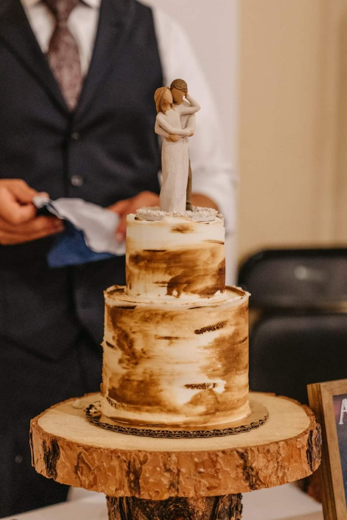Details of the wedding cake, which looked like a birch tree and had a wooden couple on the top