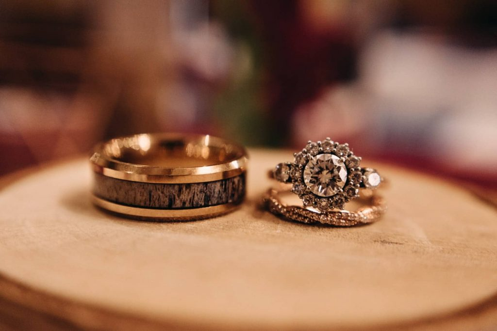 Closeup photos of the bride and groom's rings