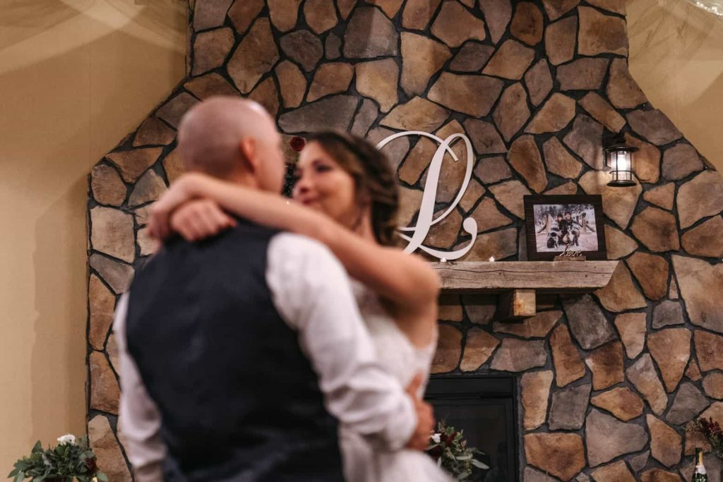 Photo of the 'L' on top of the fireplace above the bride and grooms table, which stands for their new family name