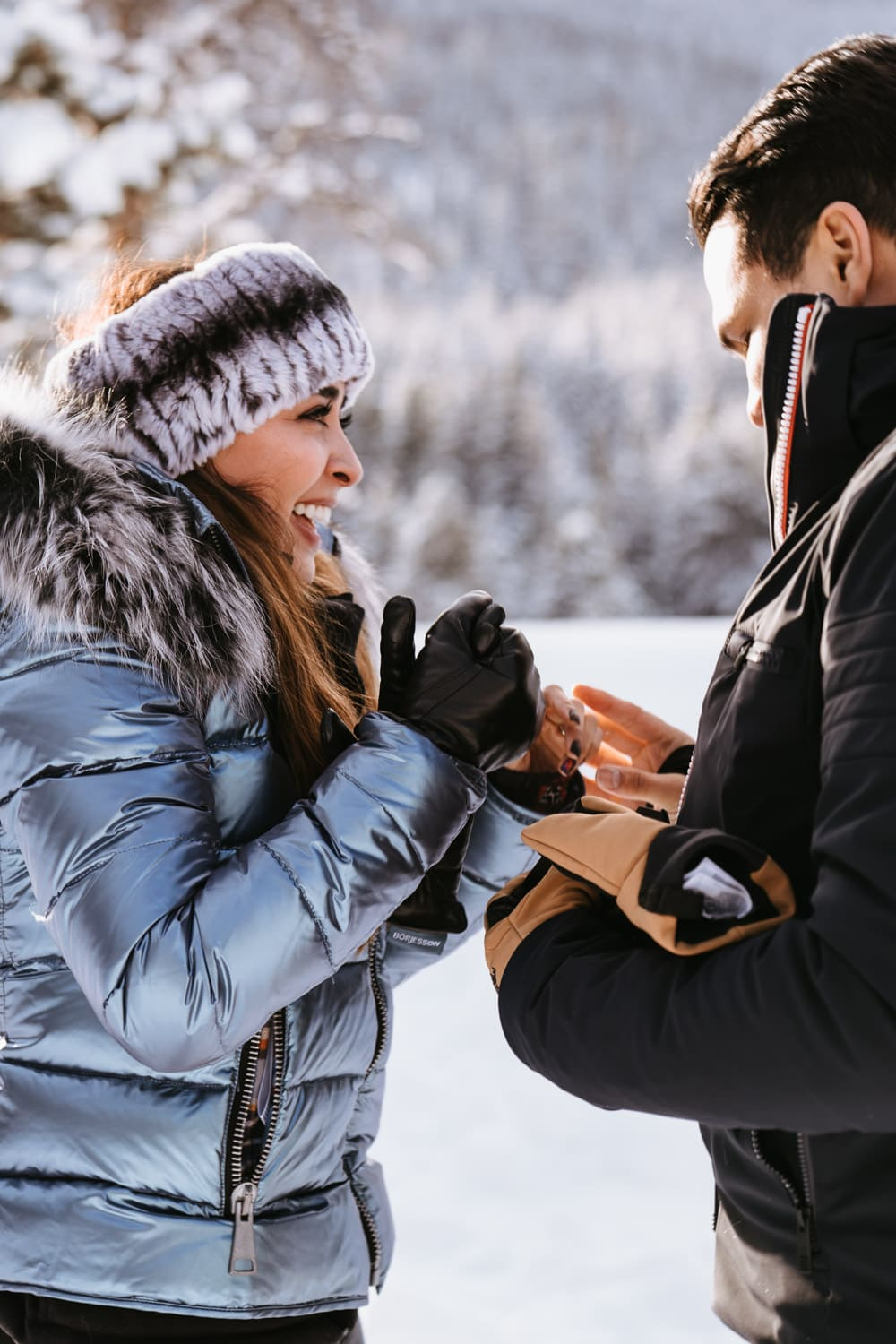Couple laughs together as they just got engaged for this sleigh ride proposal in Breckenridge