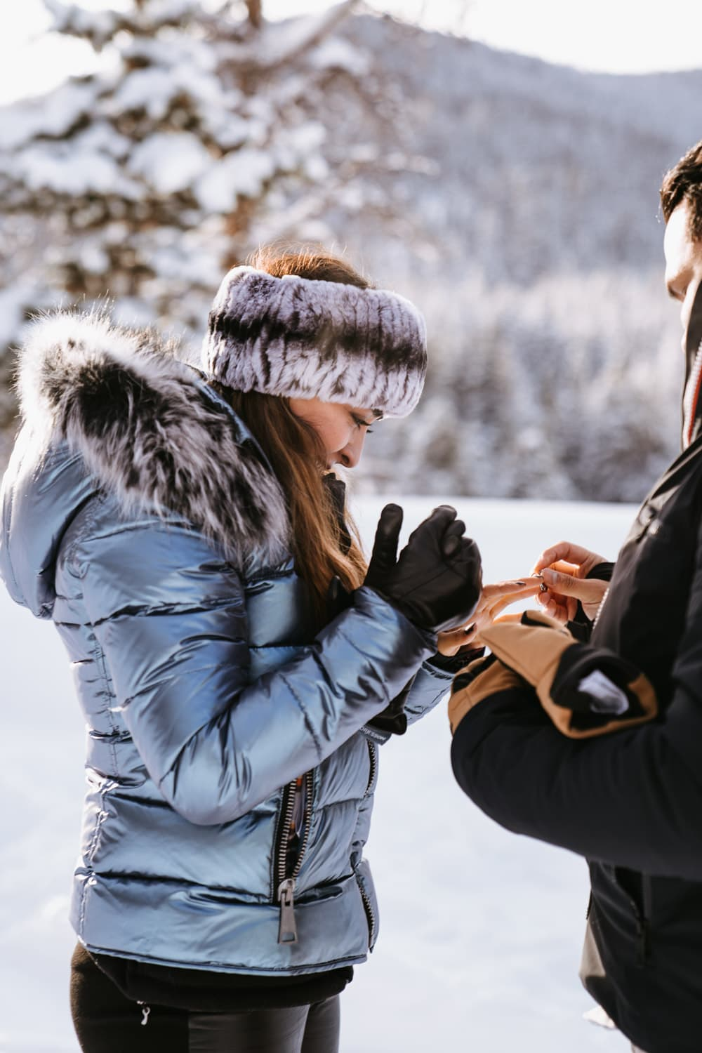Julio puts the engagement ring on Fernanda's finger for this sleigh ride proposal in Breckenridge