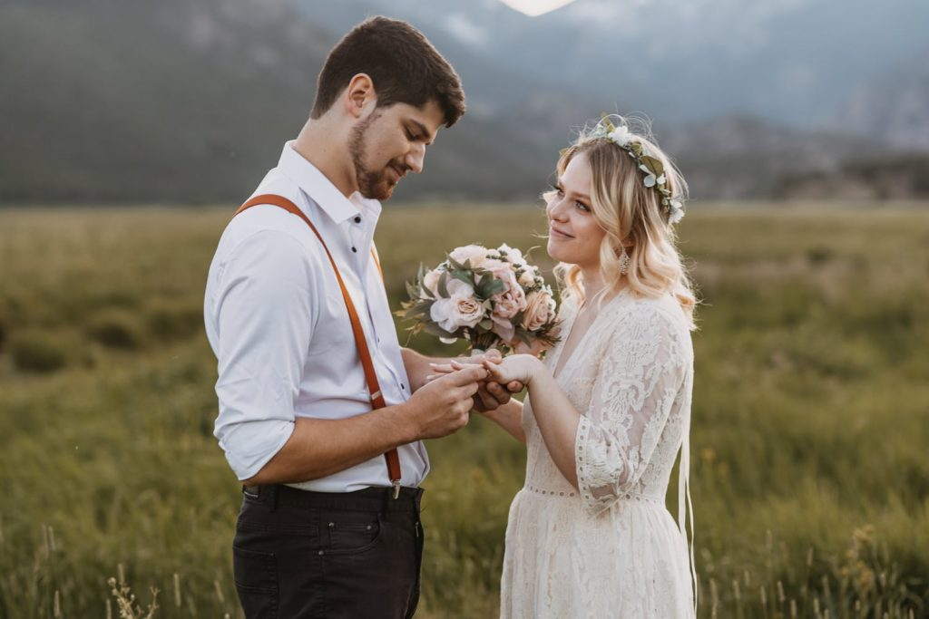 Couple exchanges rings and says 'i do'. Sarah and Jack reached out to me to find out how to elope in Colorado, and they decided on a sunset elopement in Rocky Mountain National Park