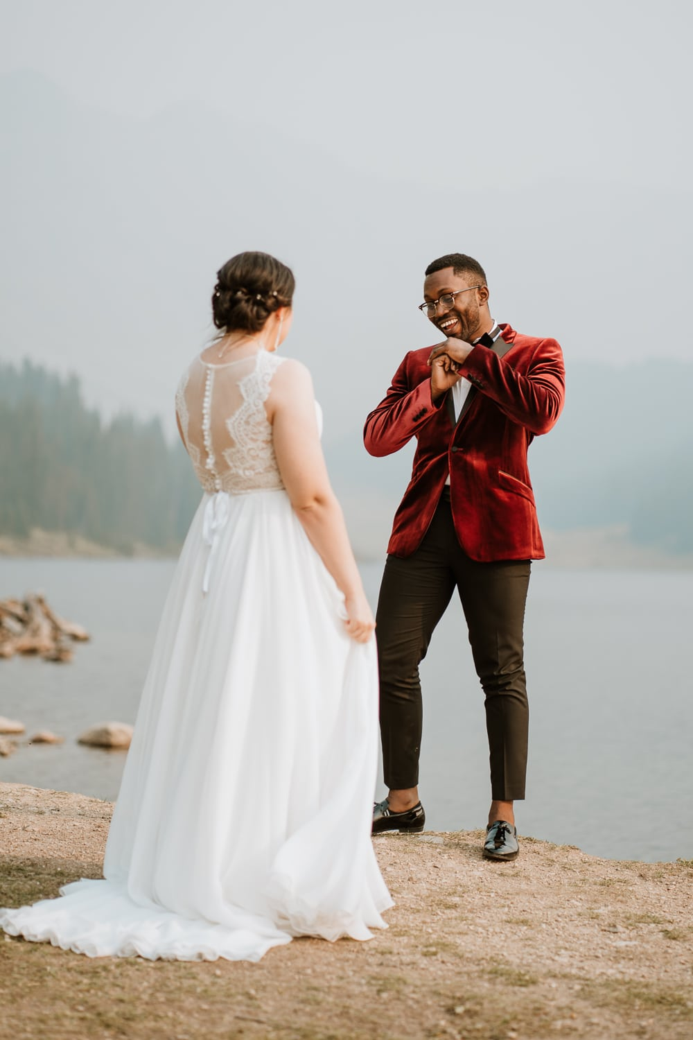 The groom busted into a dance after seeing his new bride in her wedding dress. This wedding was challenging as we learned how to plan an elopement during Colorado wildfires!