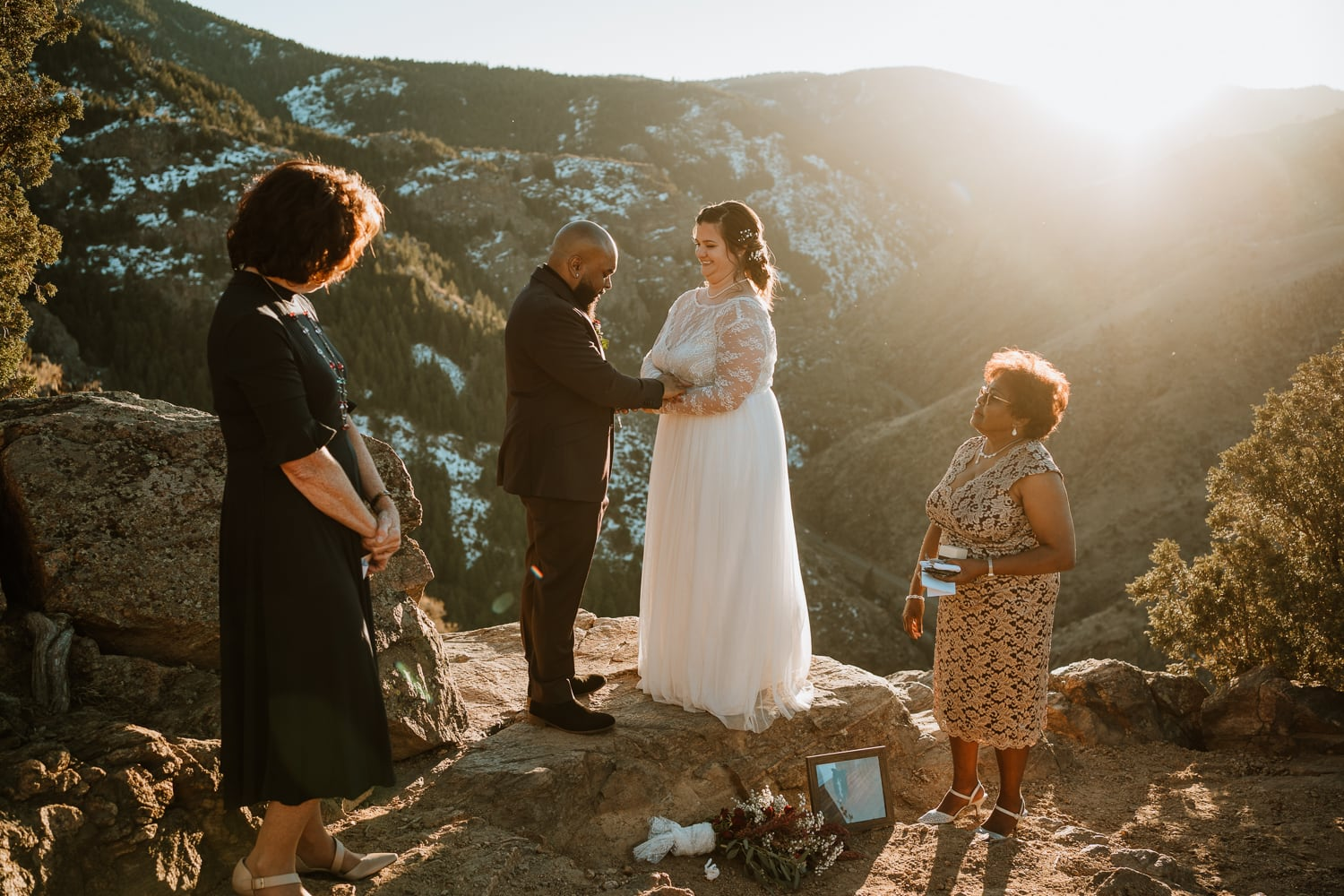 Couple reads handwritten vows to each other during their intimate sunset wedding ceremony. This bride and groom reached out to me to plan their Colorado elopement, and it turned out perfectly.