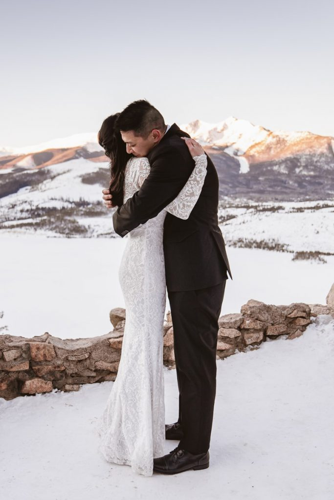 Bride and groom hug after saying their vows at their winter Sapphire Point elopement