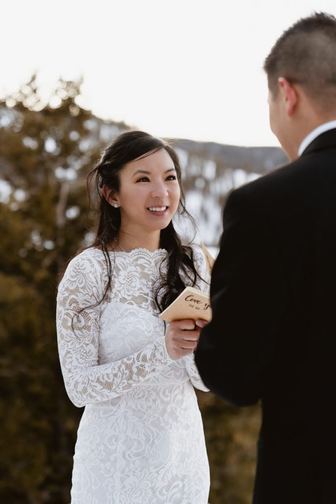 Closeup image of the bride smiling at the groom during this winter Sapphire Point Elopement