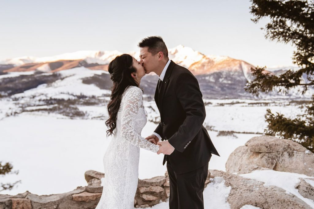 Bride and groom's first kiss after saying their wedding vows at their winter Sapphire Point elopement
