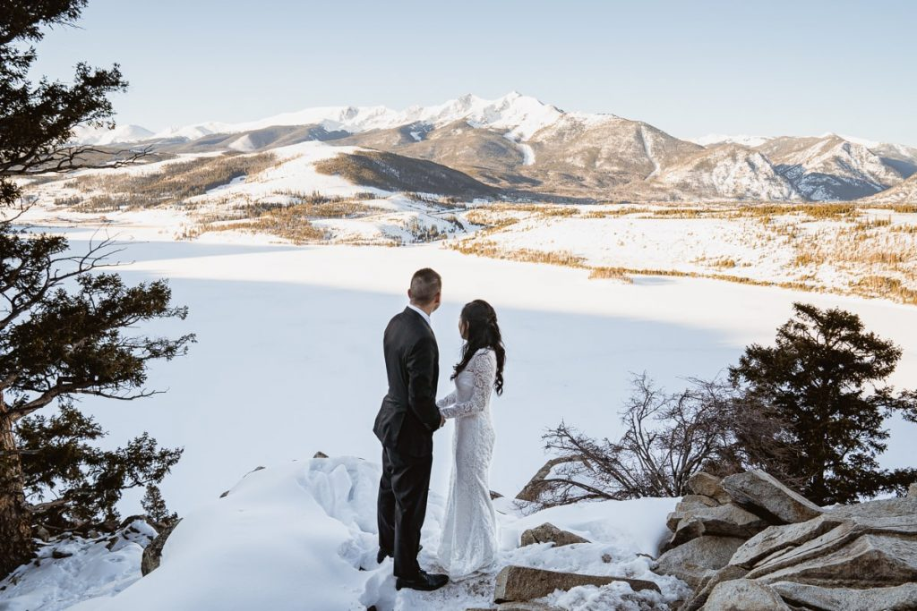 Bride and groom hold hands and enjoy the beautiful views that Sapphire Point Overlook has to offer