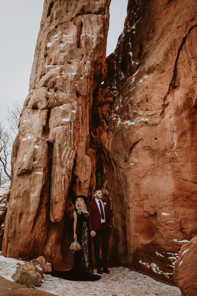 Bride and groom pose in their ceremony spot for this moody Garden of the Gods elopement images
