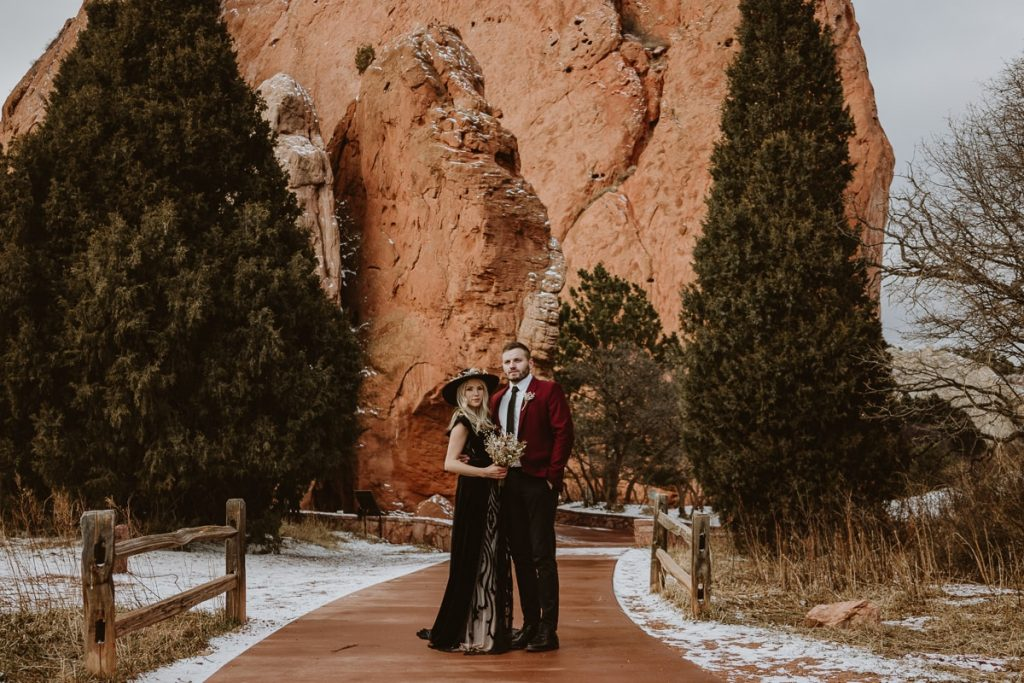 Bride and groom pose on the walking path of Central trail for this moody Garden of the Gods elopement