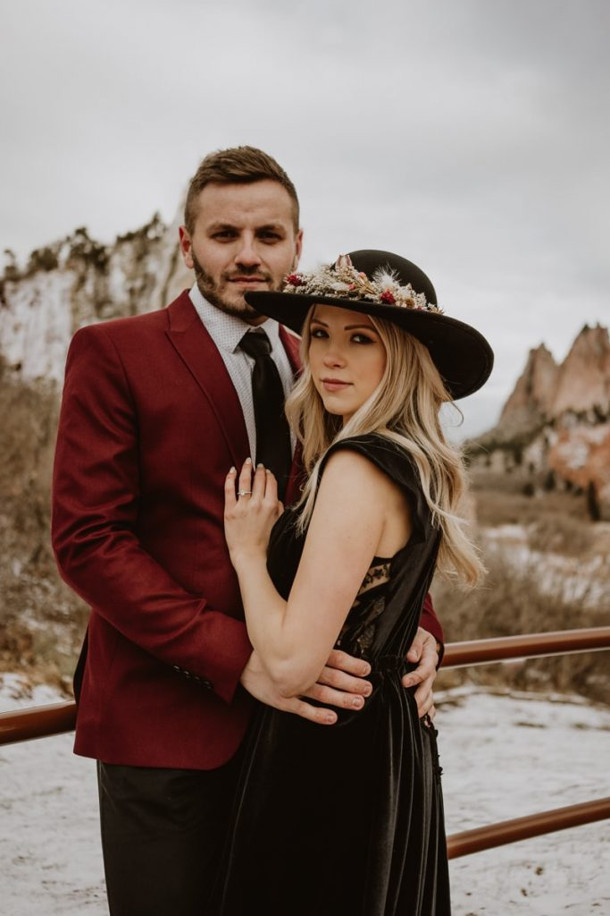 Bride and groom stare moodily into the camera for this moody Garden of the Gods elopement