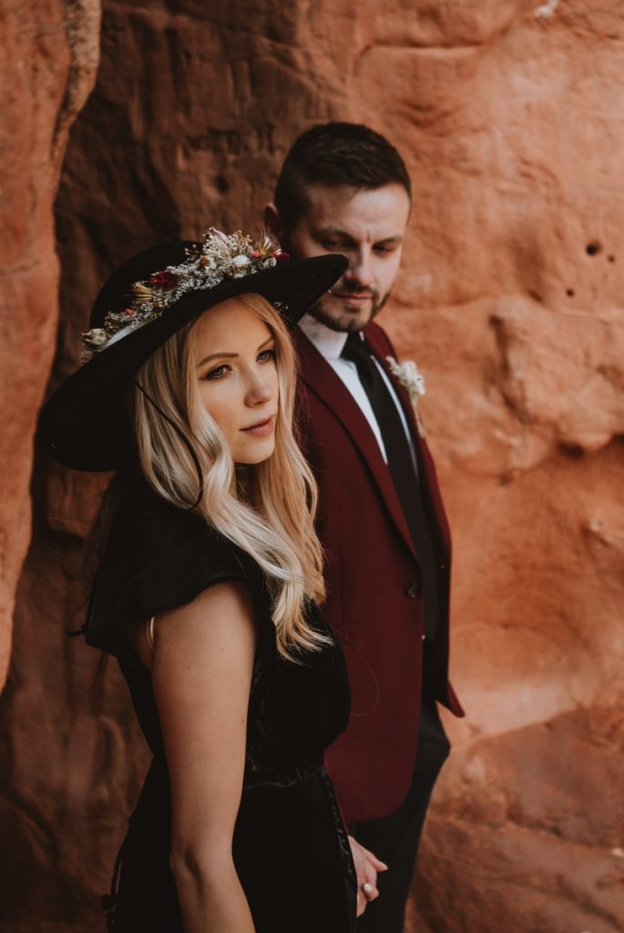 Closeup image of the bride and groom posing in the rock formations at Sentinel Plaza to produce some very dramatic Garden of the Gods wedding photos