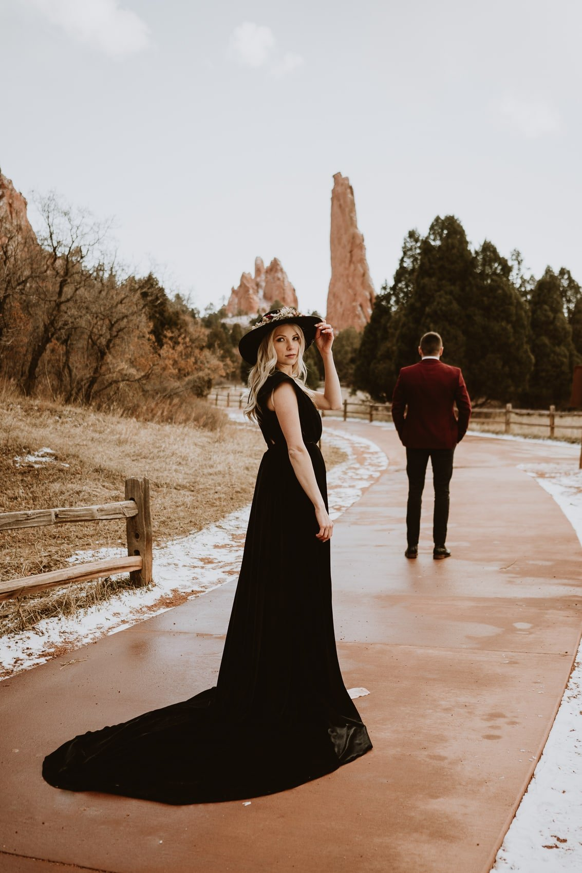Bride poses in black wedding dress during the first look for Garden of the Gods wedding photos