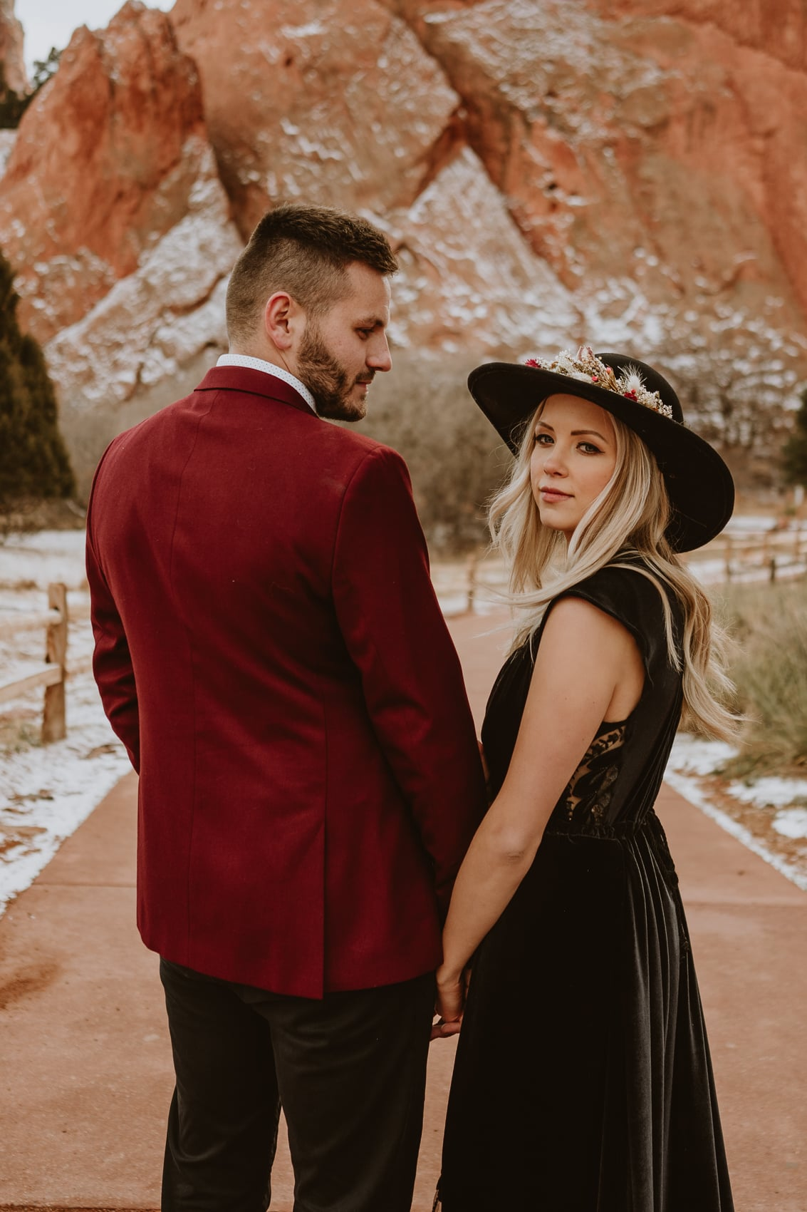 Closeup of groom looking at bride as they walk down Central trail for their Garden of the Gods elopement pictures