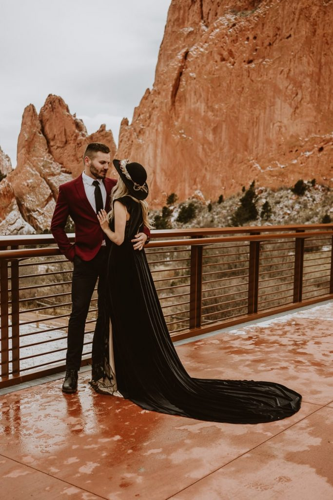 Bride and groom pose for this winter Garden of the Gods Colorado Springs elopement