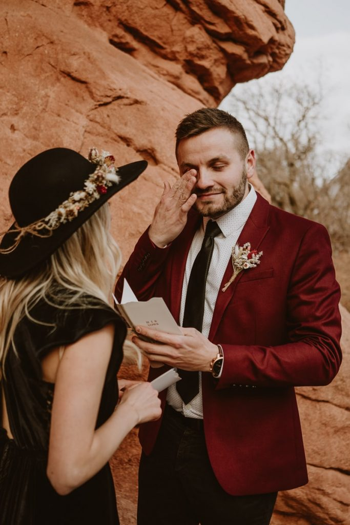 Groom gets emotional during the vow reading. I love these moments for Garden of the Gods wedding photos