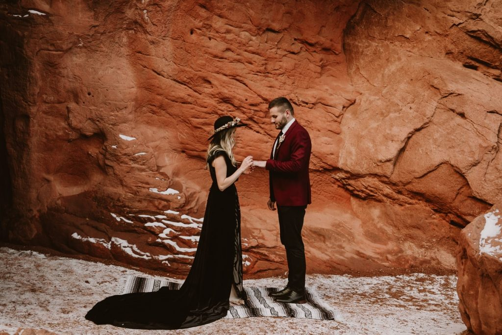 Ring exchange ceremony at winter Garden of the Gods elopement. One of the best places to elope in Colorado if you don't want to spend money on a wedding venue!