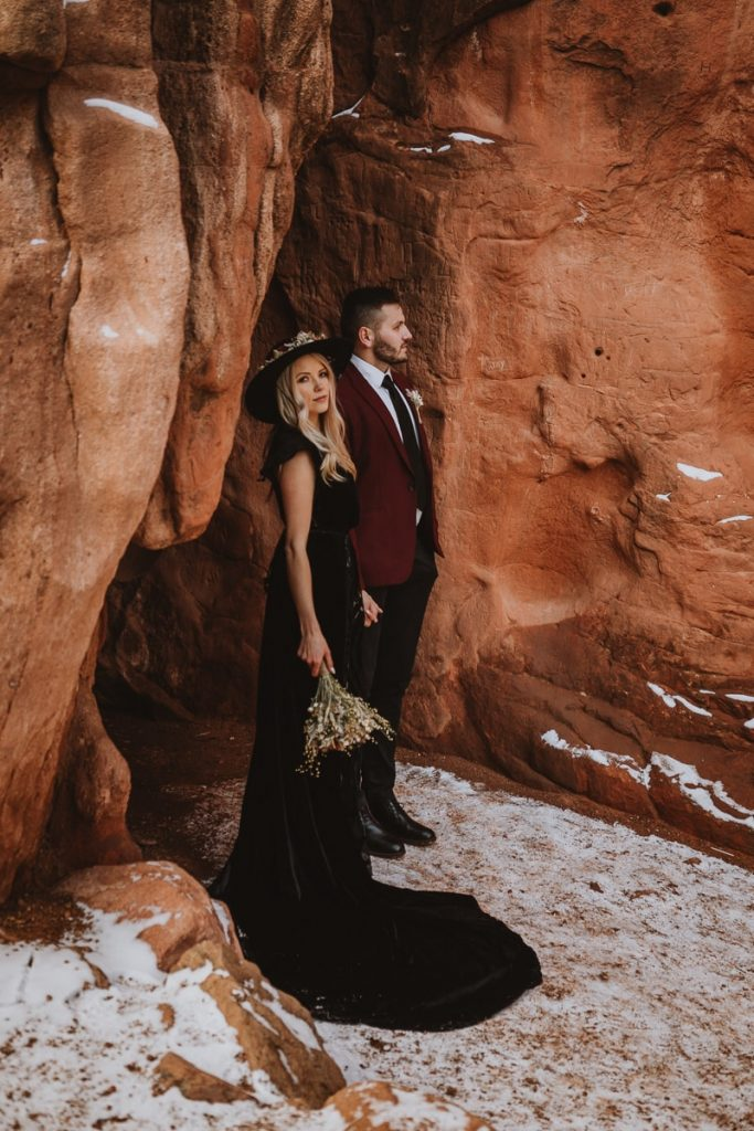 Bride and groom pose in the rock formations at Sentinel Plaza to produce some very dramatic Garden of the Gods wedding photos