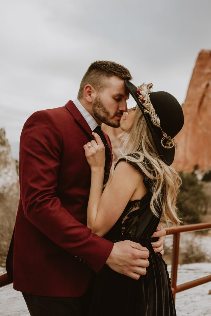 Closeup details of the groom pulling in bride for a romantic kiss during their Garden of the Gods Colorado Springs elopement