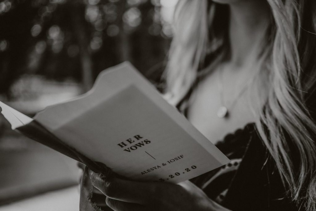 Black and white image of the vow books that were handmade by Alesya and Iosif by Luna Lynn Creative Elopement & Wedding Stationary