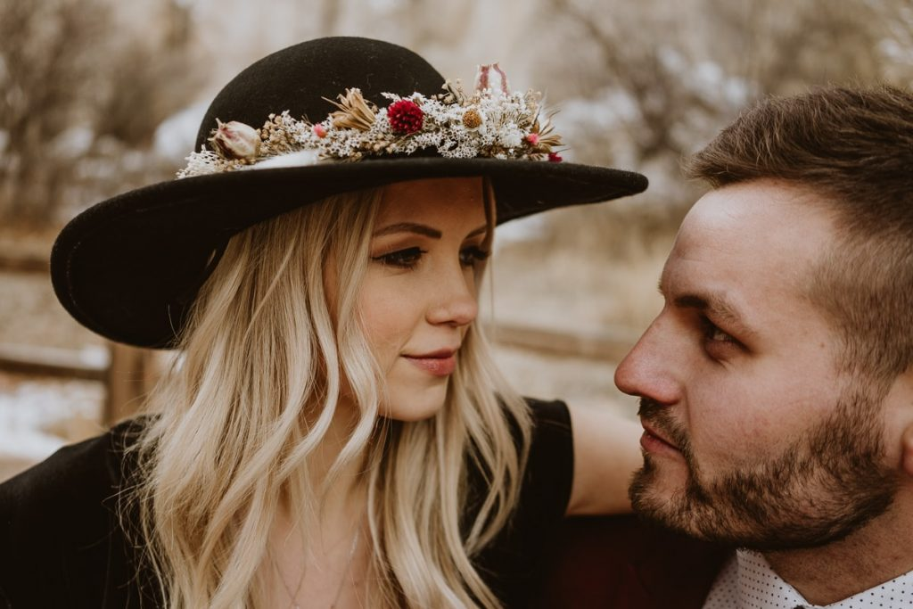 Bride and groom take a moment to look into each others eyes and smile