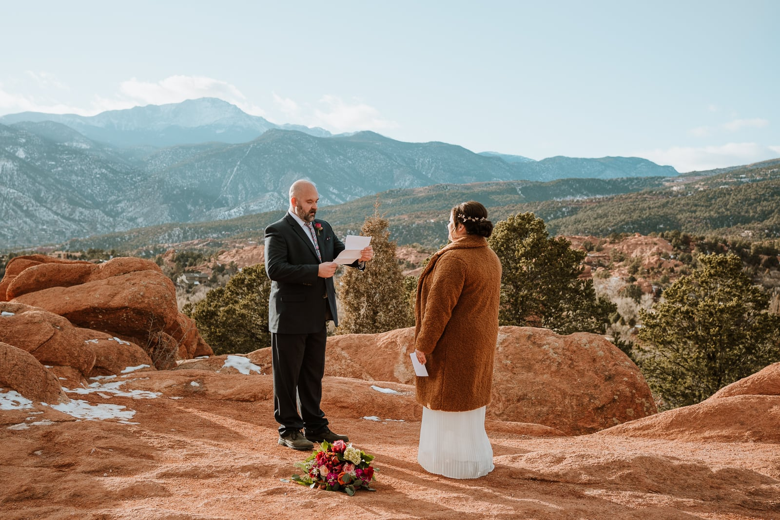 Bride and groom read their vows at High Point Overlook for this sunset elopement in December at Garden of the Gods