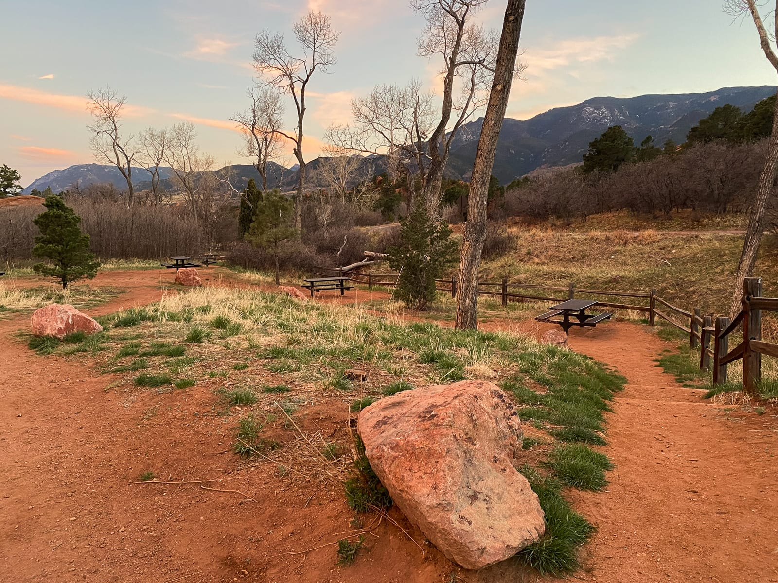 Photo of multiple picnic tables at sunset in the Scotsman Picnic Area