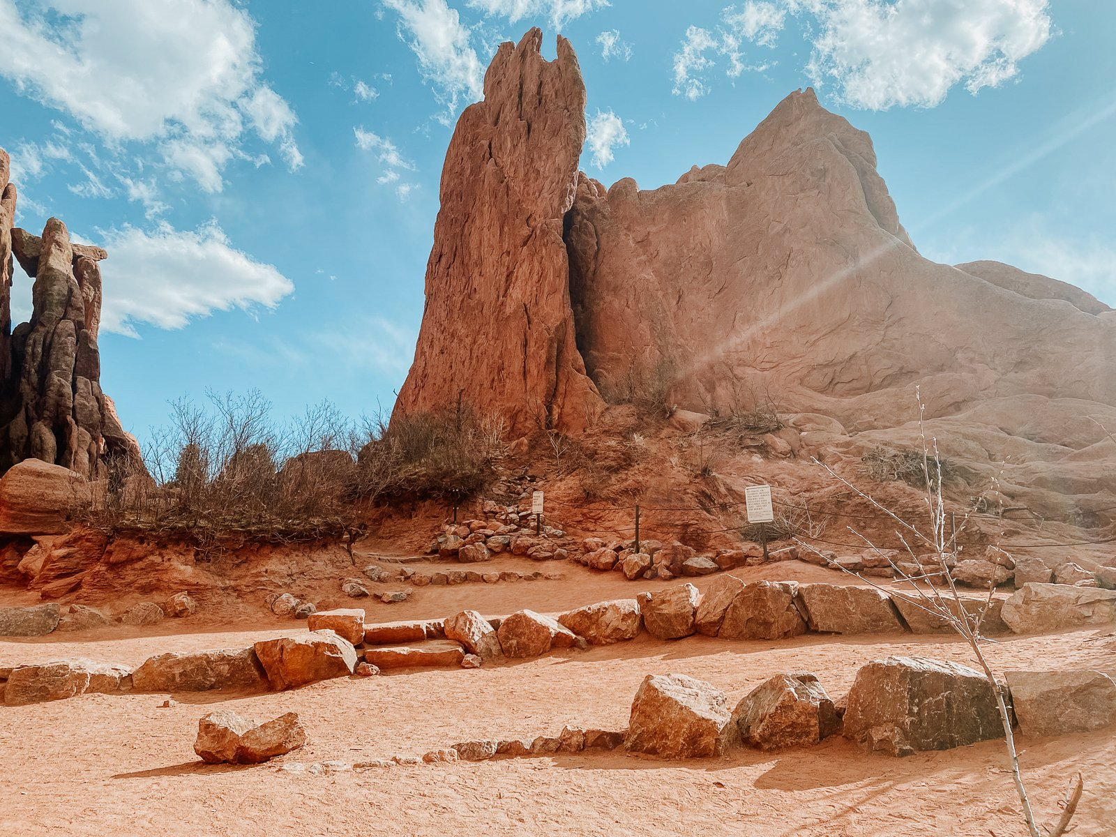 Red rocks of Three Graces Plaza jut into the sky. This location is used for elopements, intimate weddings or hiking.