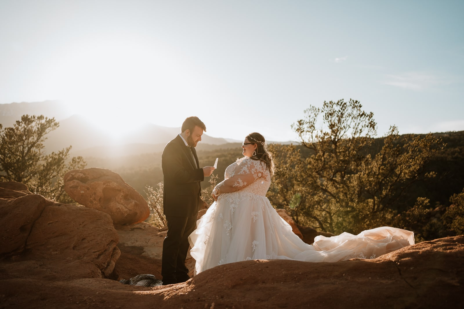 Bride and groom share their vows at sunset during this warm and sunny winter elopement in March at Garden of the Gods