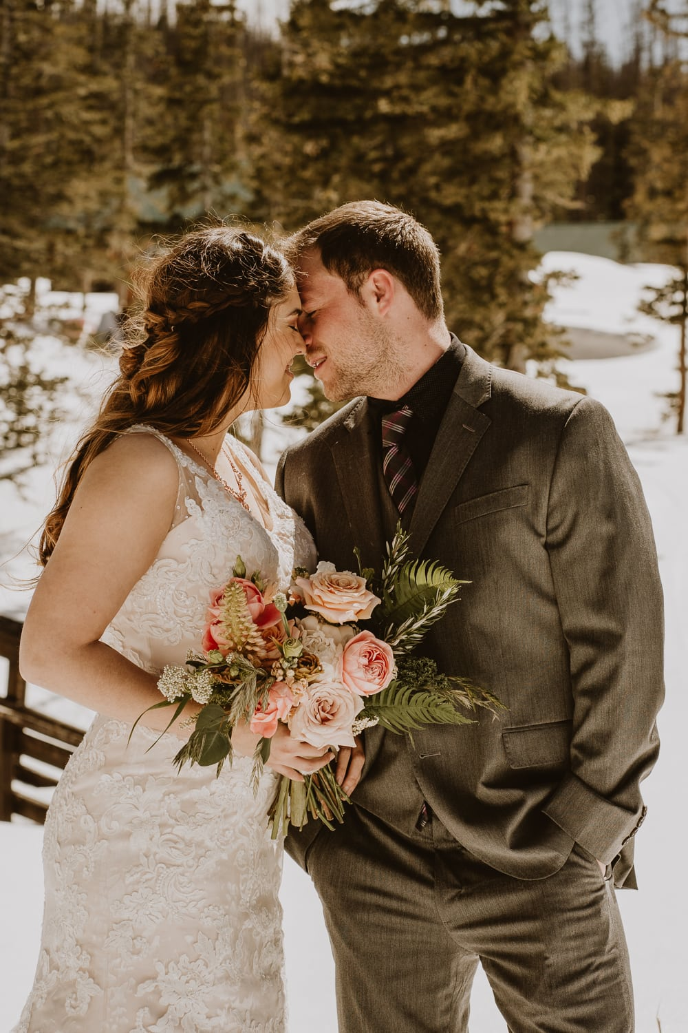 couple shares their first kiss during their adventurous winter elopement. They checked every item off their elopement checklist!