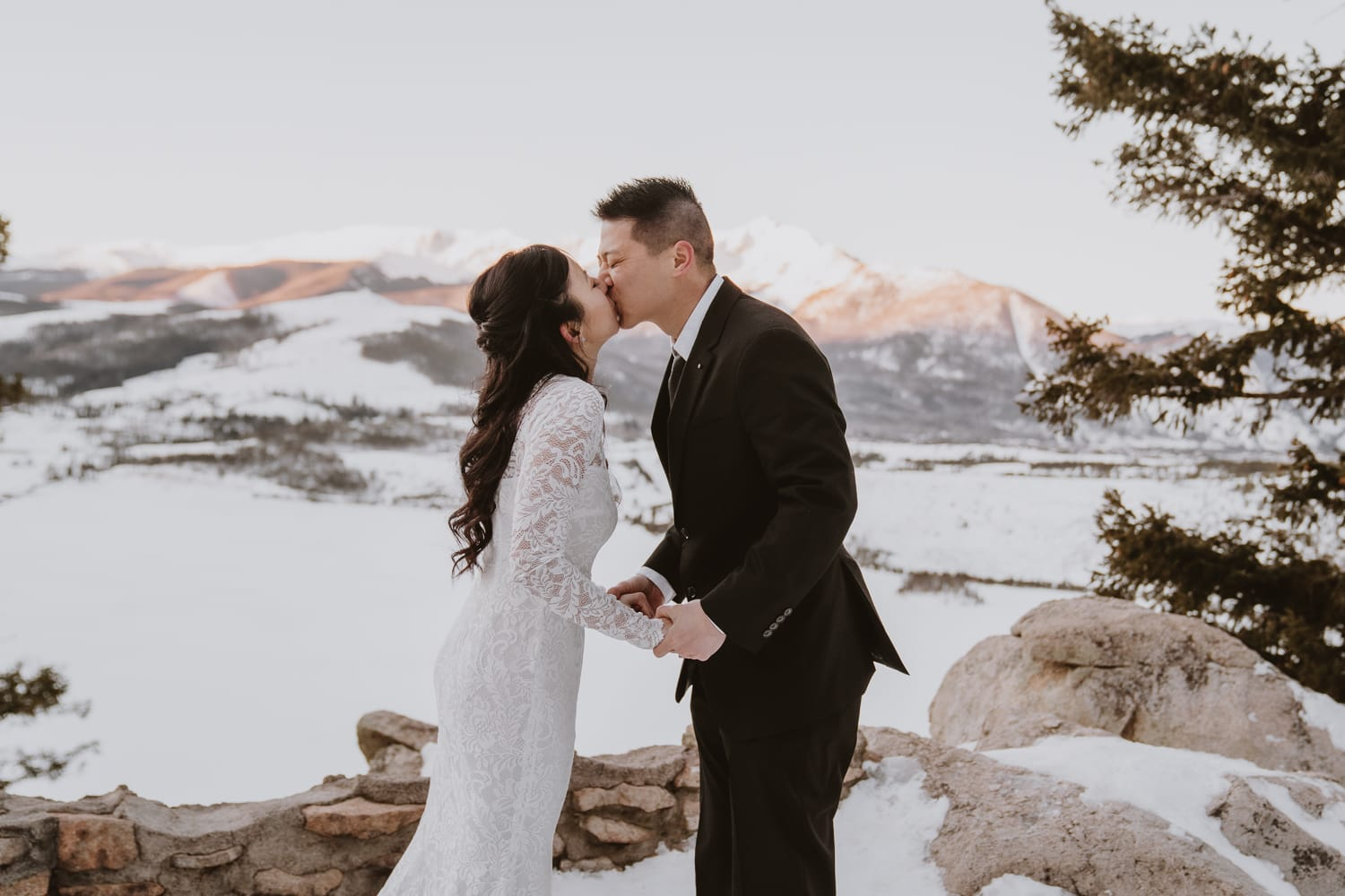 Victory and Andy eloped on a mountain top outside of Breckenridge at sunrise, and this is a photo of their first kiss!