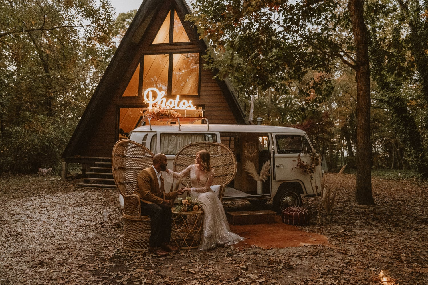 Newlywed couple poses at their romantic elopement in the woods next to their a-frame cabin