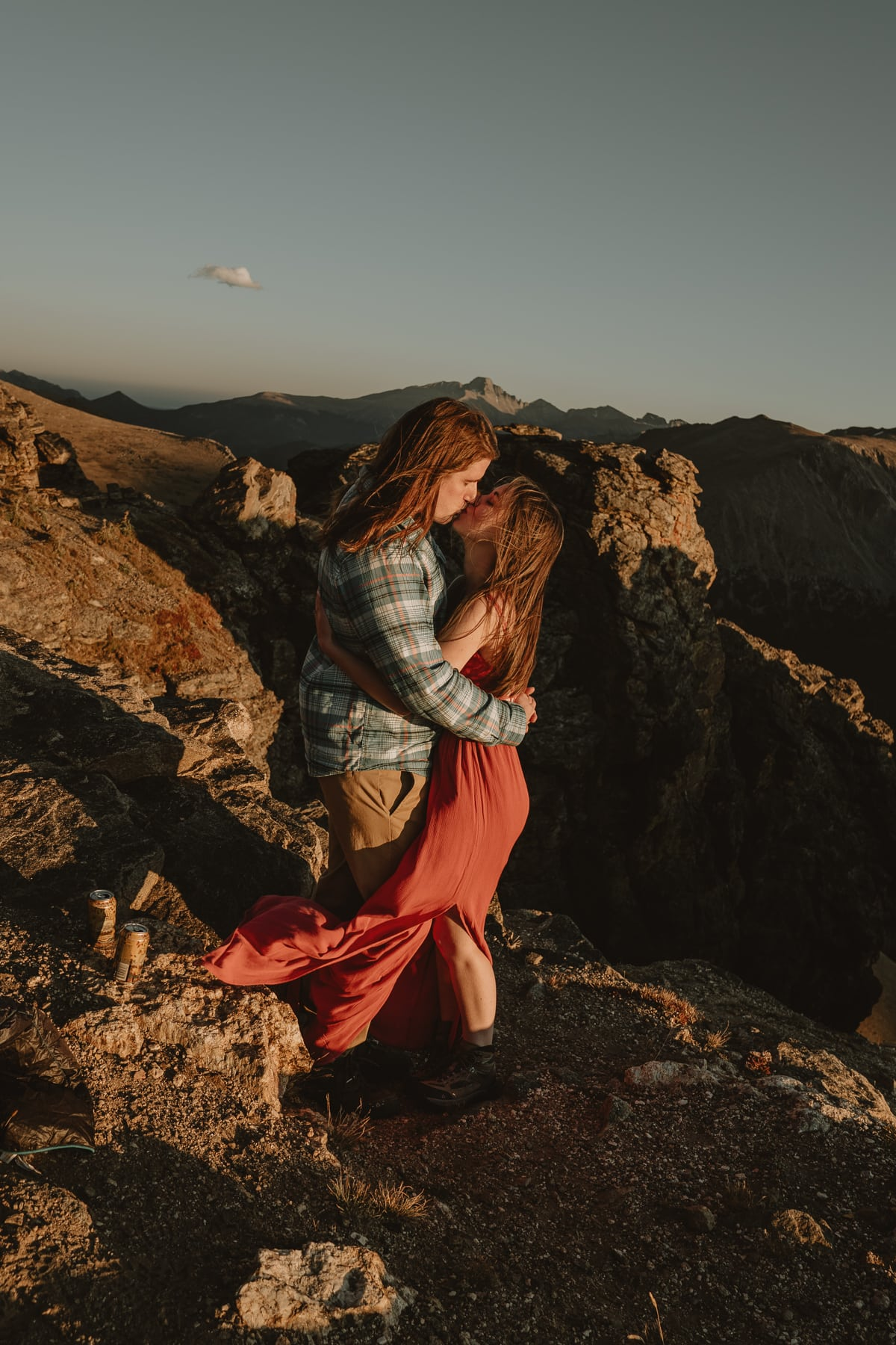 Couple kisses during sunset on top of a mountain in Colorado, one of the best places to elope