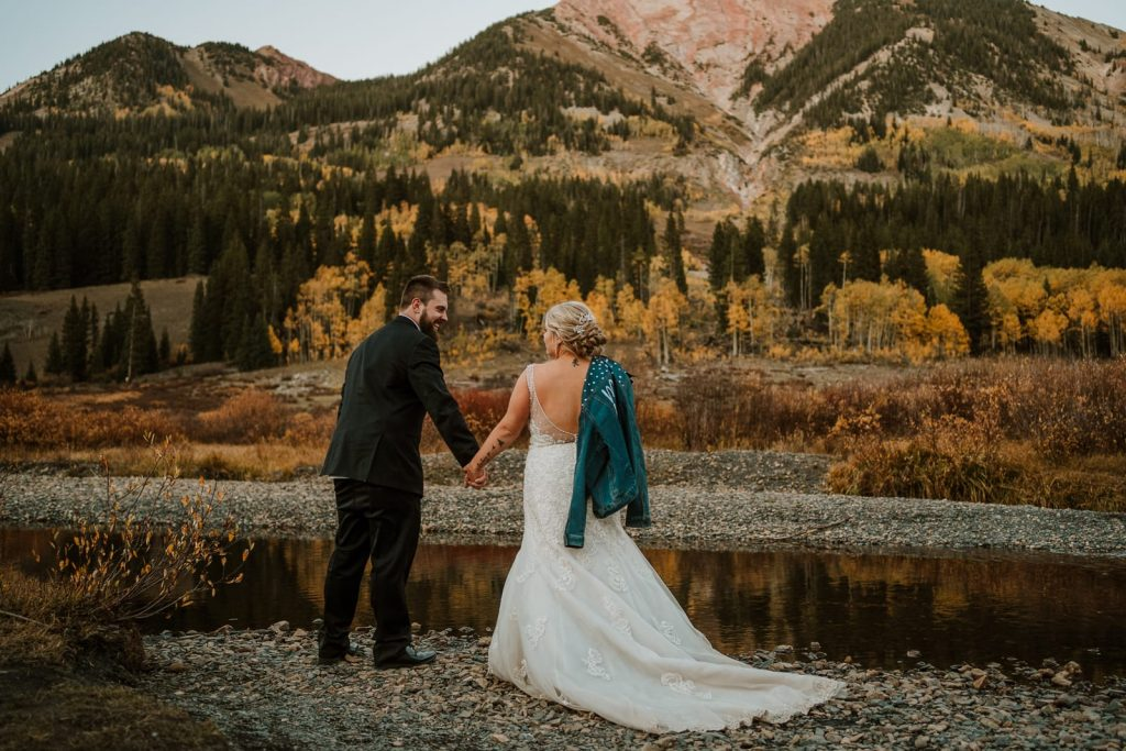 Bride and groom stand in front of a mountain in Crested Butte, one of the best places to elope in Colorado.
