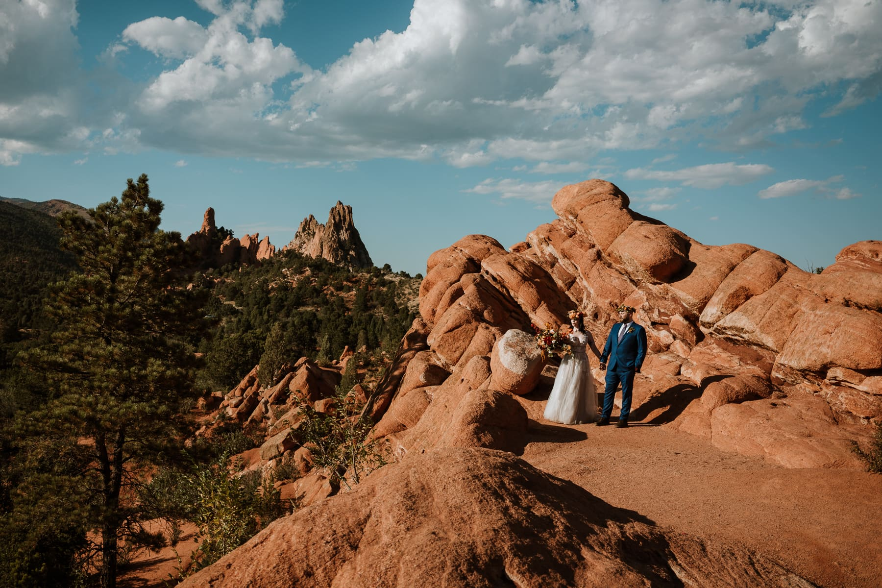 Moody garden of the gods elopement photo of a couple at sunset after their wedding
