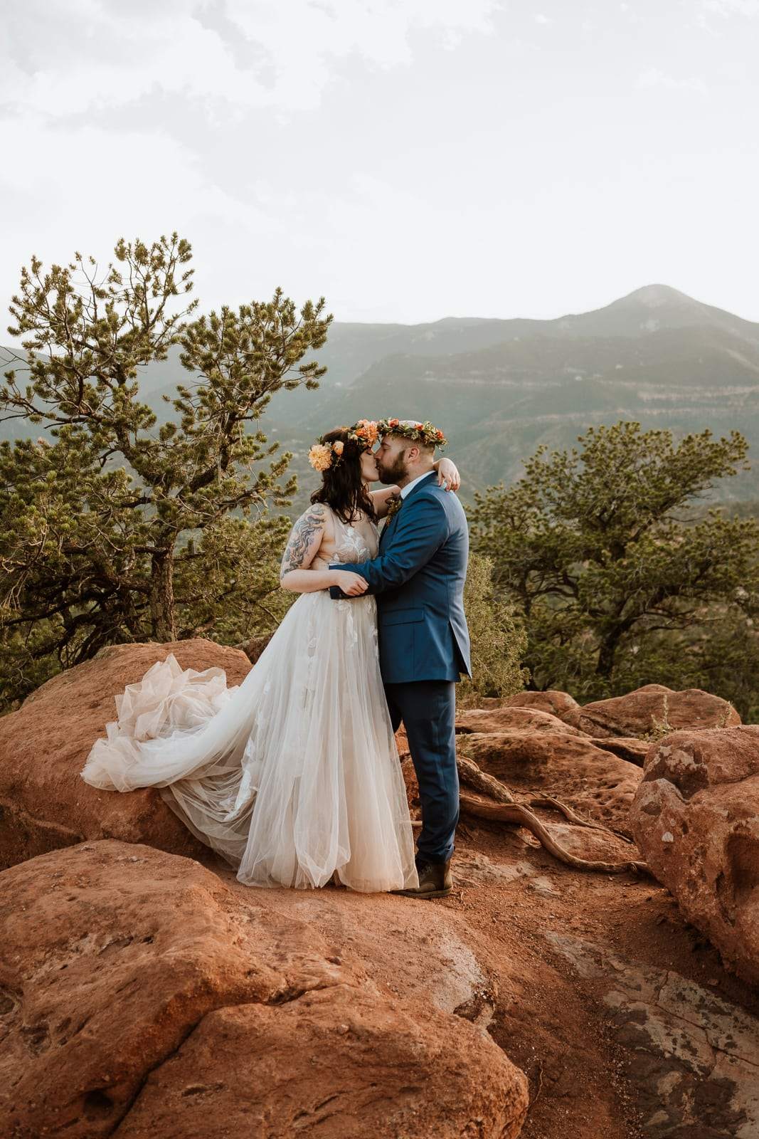 Bride and groom kiss at sunset after their Garden of the Gods elopement