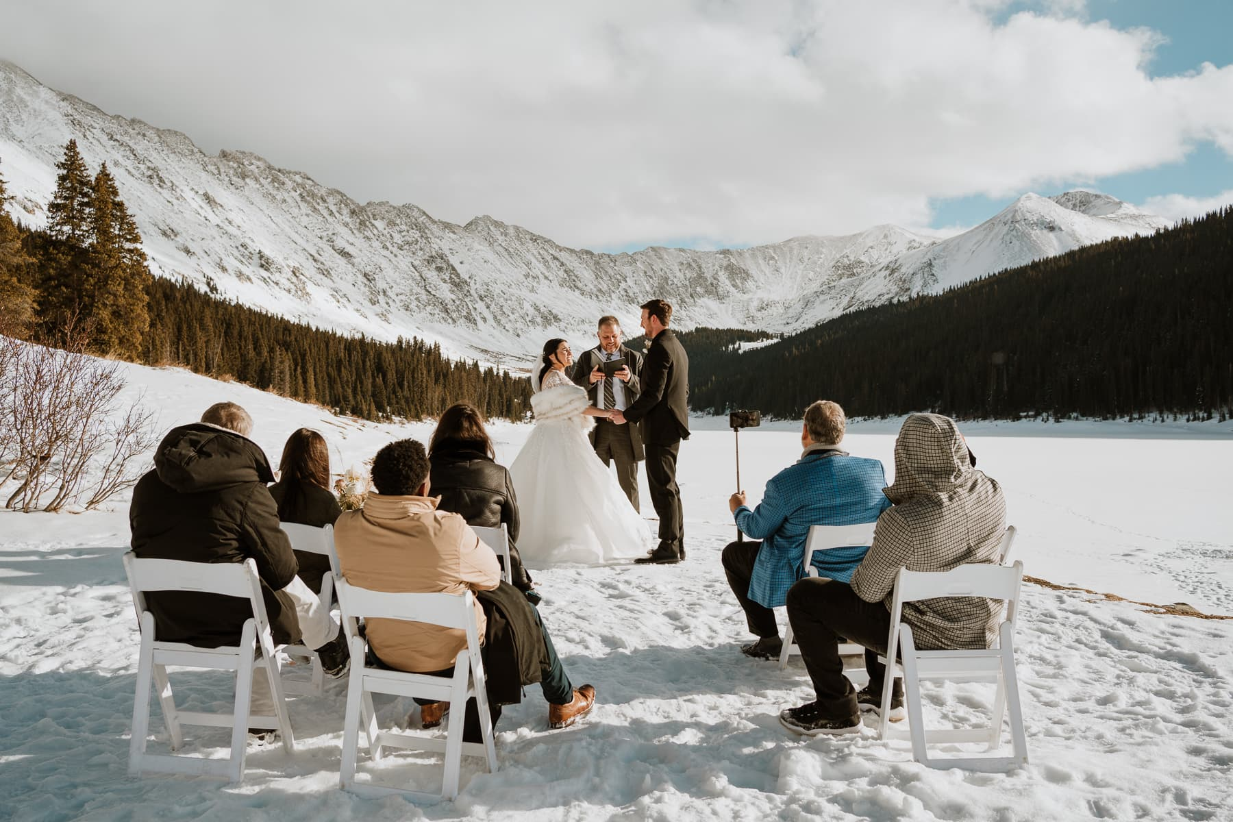 Wide photo of a small winter wedding in Colorado. The perfect example on why couples should elope in Colorado in the winter, as it's beautiful.
