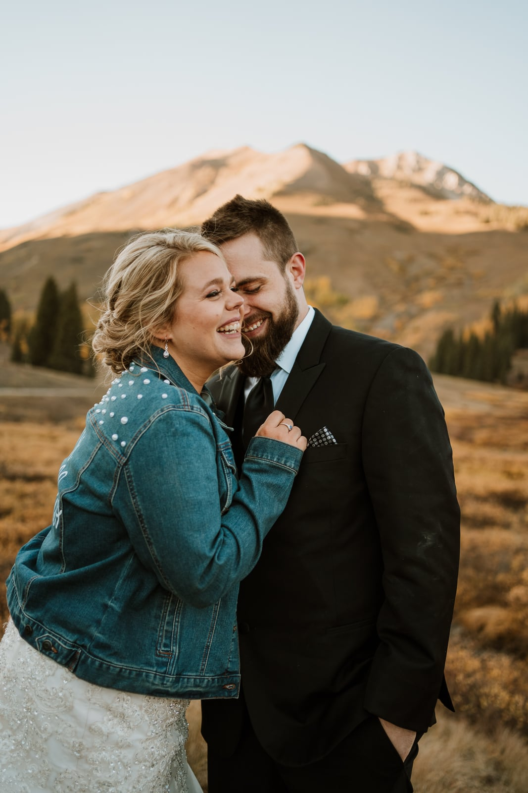 Bride and groom laugh and giggle during their first dance at their sunset Crested Butte elopement