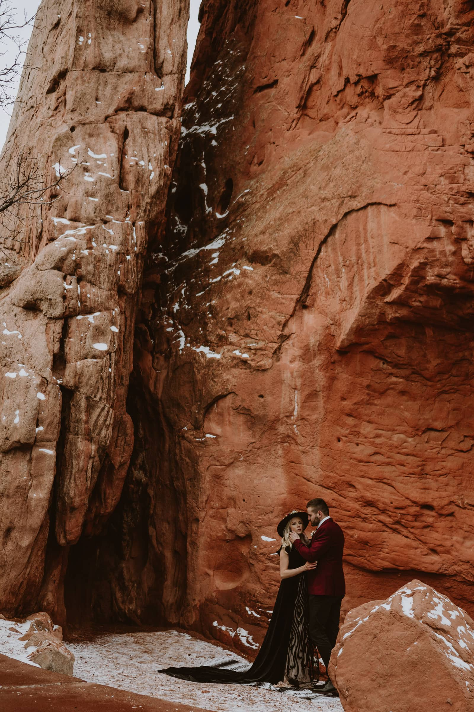 Bride and groom pose in Sentinel Plaza for this romantic moody Garden of the Gods elopement