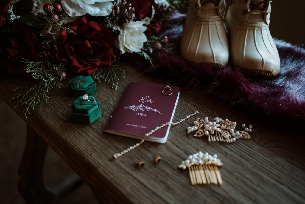 Bridal details laid out on the table. The perfect photo to represent an elopement checklist with downloadable pdf!