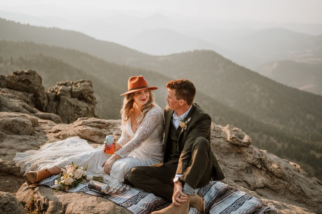 Bride and groom planned their elopement so they could have a picnic at sunset to soak in all the Colorado views