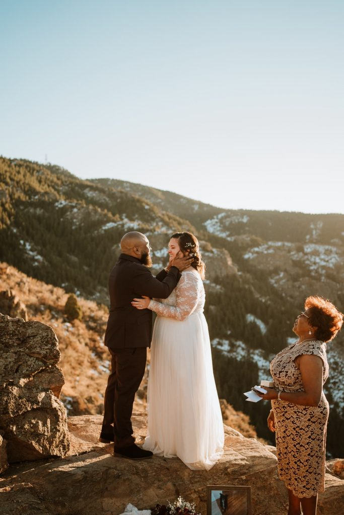 Adorable couple shares first kiss on top of Lookout mountain in Colorado after eloping