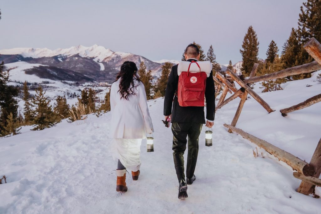 Bride and walk to their sunrise ceremony. They hired me as their Colorado elopement photographer for their Sapphire Point elopement in Colorado