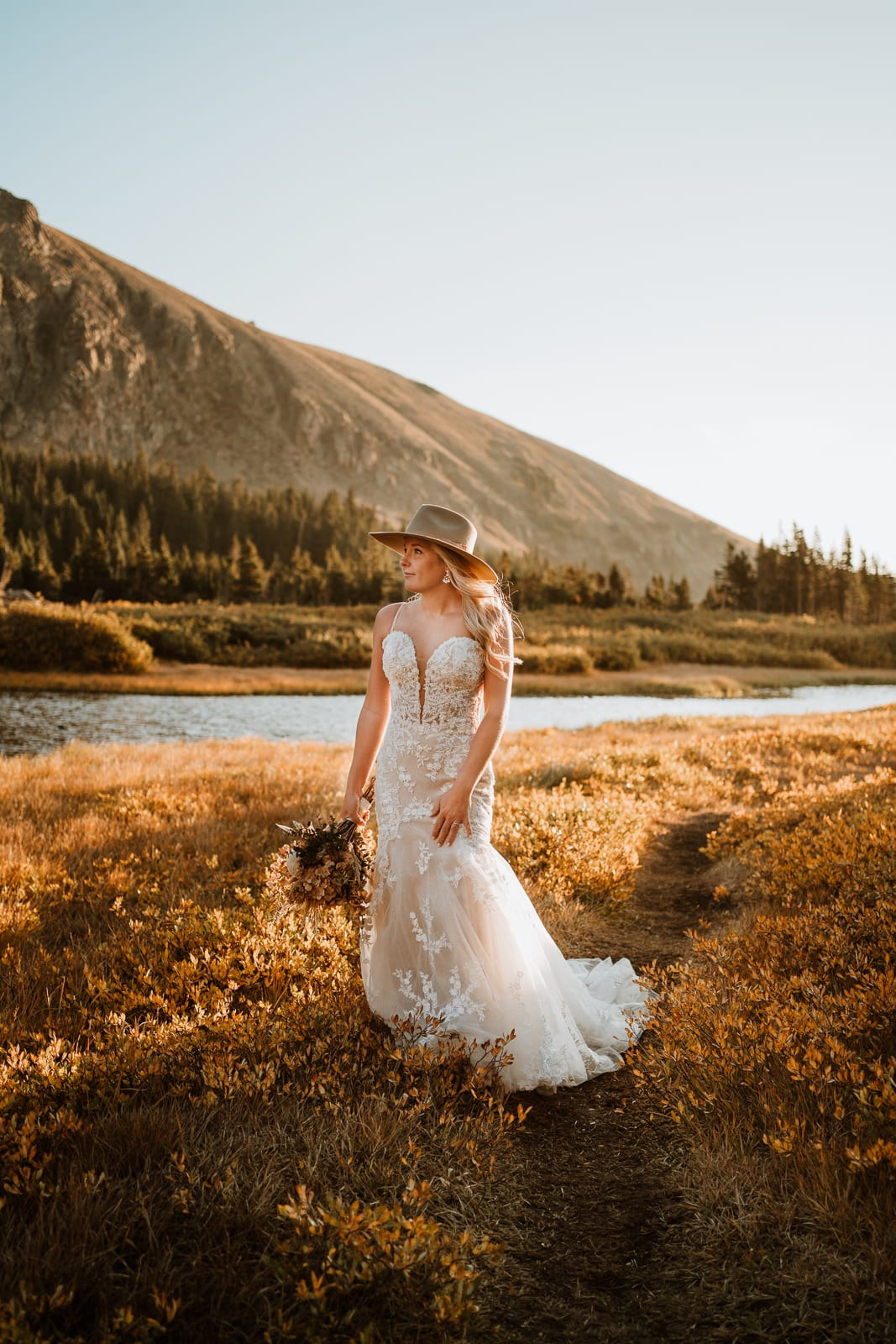 Bride poses moodily during sunrise at this secluded Colorado lake